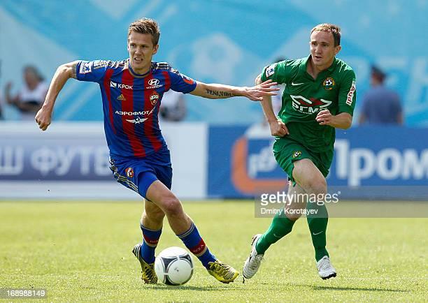 Pontus Wernbloom of PFC CSKA Moscow is challenged by Aleksei Kozlov of FC Kuban Krasnodar during the Russian Premier League match between PFC CSKA...