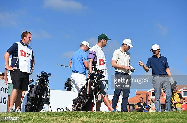 Pontus Widegren of Sweden and Roope Kakko of Finland check the balls on the 1st hole during day four of the Madeira Islands Open Portugal BPI at Club...