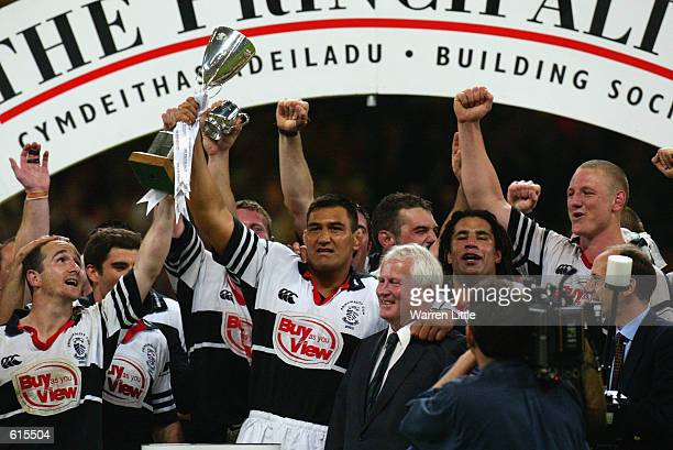 Pontypridd players celebrate winning the cup after the Principality Cup Final between Llanelli and Pontypridd played at the Millennium Stadium, in...