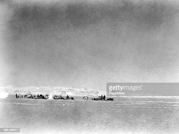 A pony party halting at a cairn taken during the last tragic voyage to Antarctica by Captain Robert Falcon Scott and his crew among them Lieutenant...
