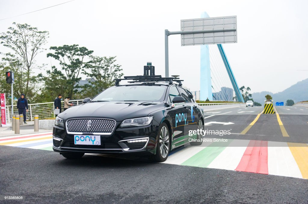 Pony ai self-driving cars run along a road during a trial