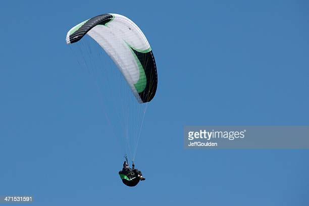 White Paraglider on Blue Sky