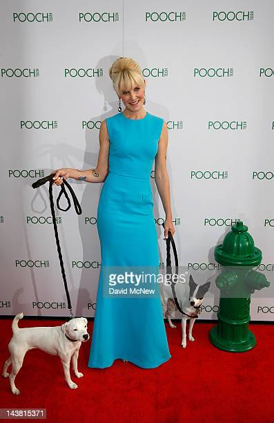 Pooch Hotel founder Robin Tomb poses on the red carpet at the grand opening of the fourth Pooch Hotel on May 3 2012 in Hollywood California The Pooch...