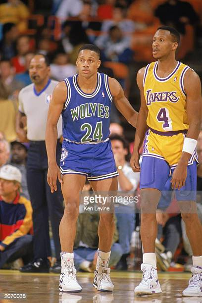 Pooh Richardson of the Minnesota Timberwolves and Byron Scott of the Los Angeles Lakers stand on the court during a game at the Great Western Forum...