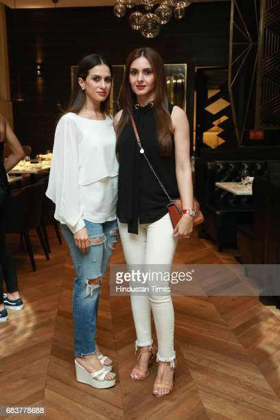 Pooja and Gunjan Batra during special dinner for Royal Challengers Bangalore teammates by Virat Kohli at his new restaurant Nueva RK Puram on May 12...