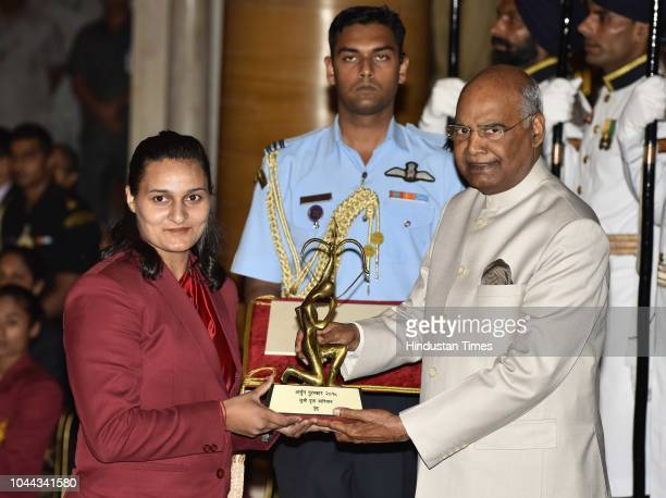 Pooja Kadian receives Arjuna Award 2018 for her achievements in Wushu from President Ram Nath Kovind at National Sports and Adventure Award 2018 at...