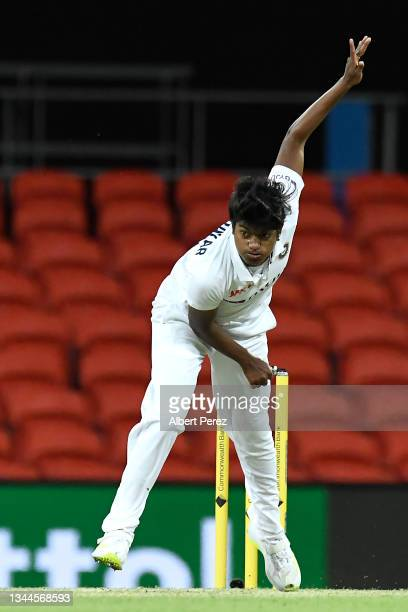 Pooja Vastrakar of India bowls during day four of the Women's International Test Match between Australia and India at Metricon Stadium on October 03,...