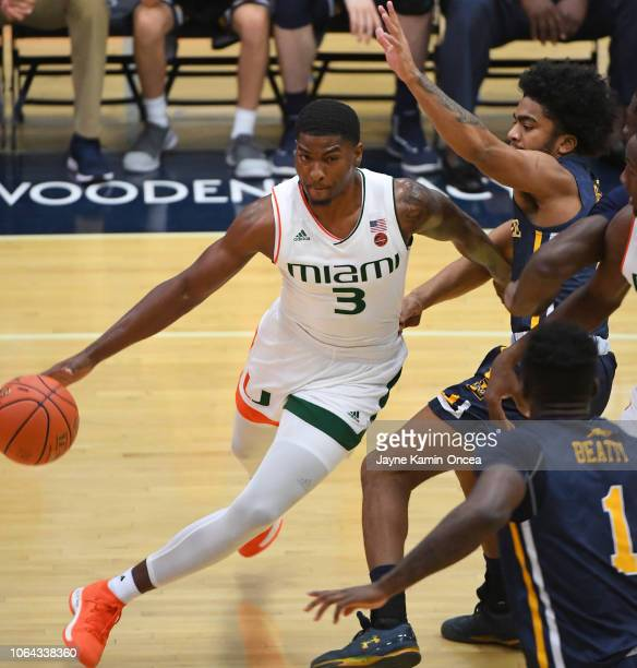 Pookie Powell of the La Salle Explorers guards Anthony Lawrence II of the Miami Hurricanes as he makes a pass under the basket in the first half of...