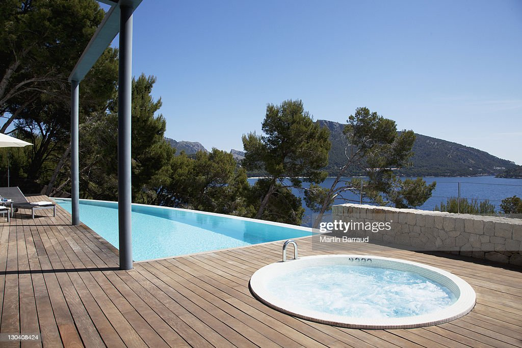 Pool and hot tub on patio : Stock Photo