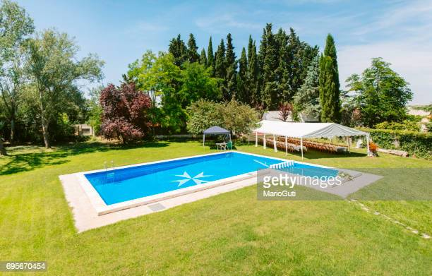 pool at house garden - maltese cross stock photos and pictures