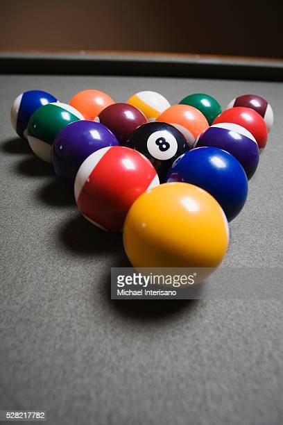 Pool Balls On A Billiard Table With The Eight Ball Facing Upwards