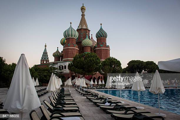 Pool chairs are seen in front of a replica of Russia's St Basil's Cathedral at a Russian themed resort on July 11 2016 in Antalya Turkey Russian...