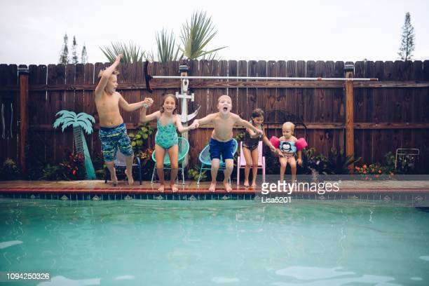 pool days are the best days - standing water stock pictures, royalty-free photos & images