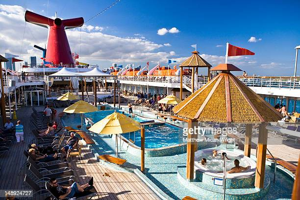 pool deck of carnival cruise line ship. - carnival cruise stock pictures, royalty-free photos & images