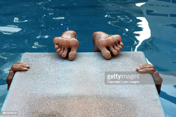 pool, diving board, hands, feet - lynn pleasant stock pictures, royalty-free photos & images