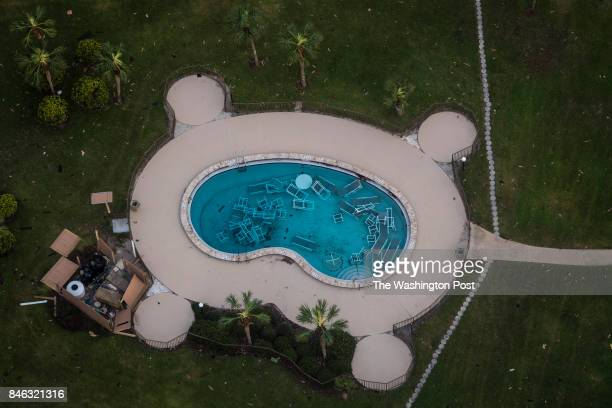 A pool full of furniture is seen next to a destroyed building along the beach in the aftermath of Hurricane Irma in Palm Coast Fla on Tuesday Sept 12...