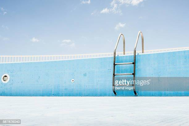 Pool ladder in empty pool