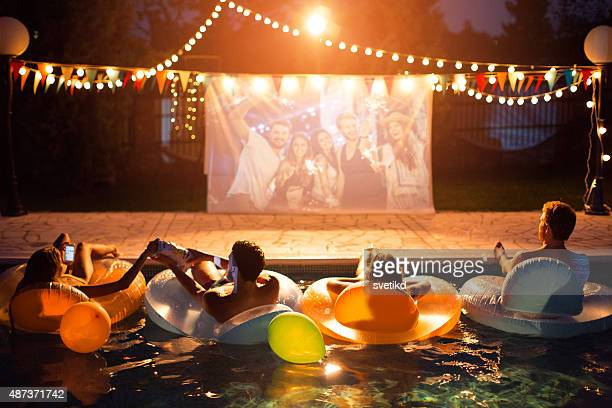 pool movie night party. - outdoor party stock pictures, royalty-free photos & images