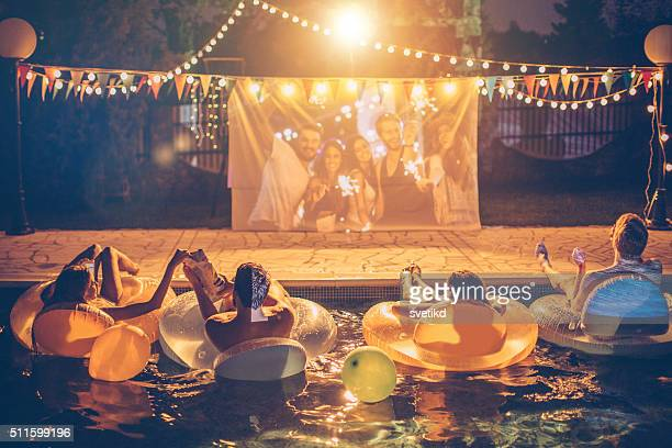 pool movie night party - pool party stock pictures, royalty-free photos & images