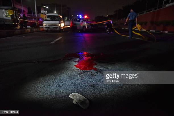 A pool of blood was left on an avenue following a shooting by an unknown assailant of a man on November 15 2016 in Pasay city Philippines Filipino...