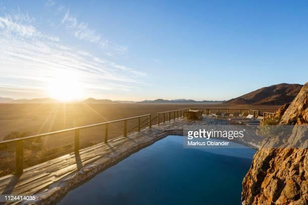 pool on the mountain, elegant desert lodge, sesriem, namibia - セスリエム ストックフォトと画像