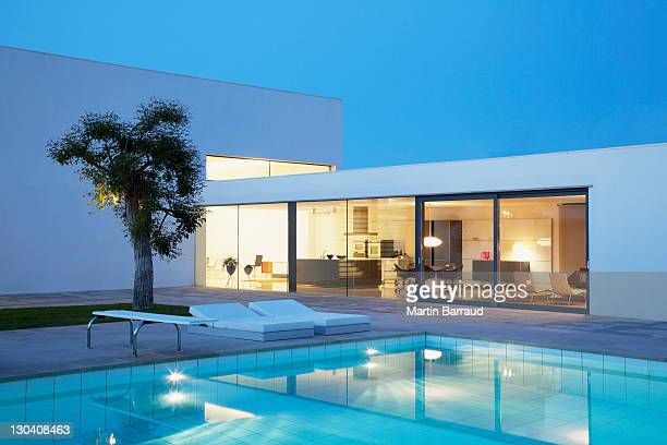 pool outside modern house at night - mediterranean culture stock pictures, royalty-free photos & images