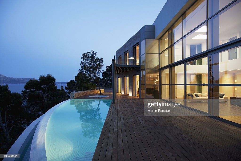 Pool outside modern house at twilight : Stock Photo