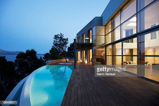 pool outside modern house at twilight - luxury stock pictures, royalty-free photos & images