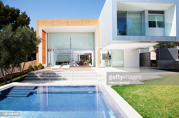 pool outside modern house - residential building stock pictures, royalty-free photos & images
