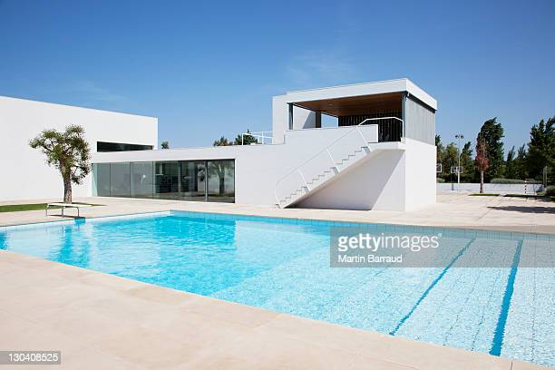 pool outside modern house - poolside stock pictures, royalty-free photos & images