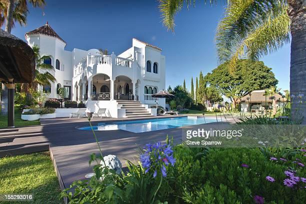 Pool outside tropical villa