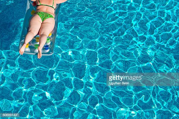 pool - chubby swimsuit stock photos and pictures