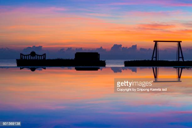 pool reflection of beautiful sky during sunrise. - prachuap khiri khan province stock pictures, royalty-free photos & images