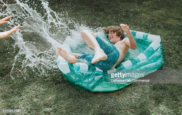 pool shove - kids pool games stock pictures, royalty-free photos & images