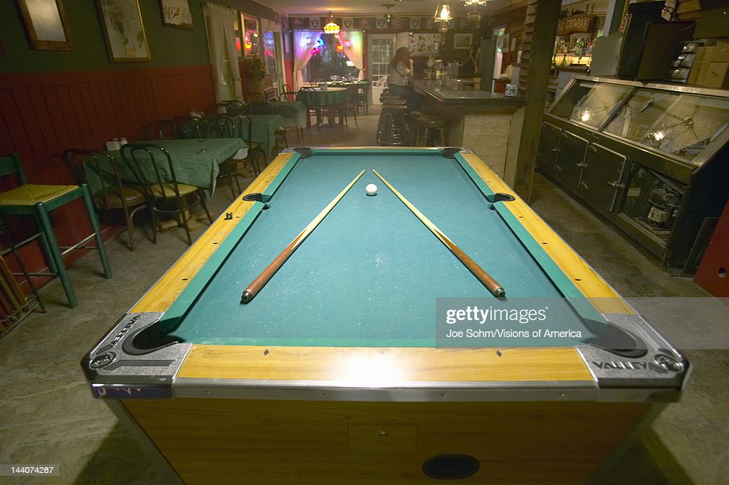 Pool Table Lit By Electric Lights In A Restaurant And Bar In - Pool table and bar near me