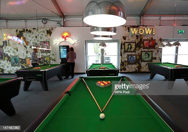 Pool tables are illuminated in the Globe bar in the Olympic Village built for the London 2012 Olympic Games on June 29 2012 in Stratford east London...