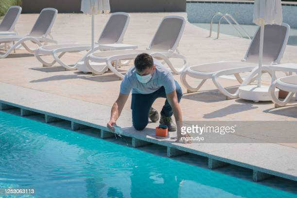 pool testing kit being used in a swimming pool - scuba mask stock pictures, royalty-free photos & images