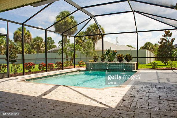 pool with screen enclosure - confined space stock pictures, royalty-free photos & images