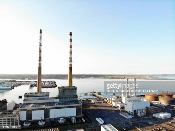 poolbeg chimneys - tower stock pictures, royalty-free photos & images