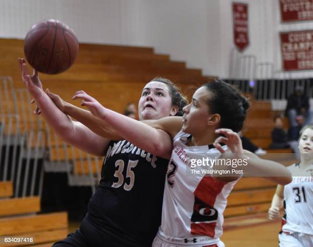 Poolesville C Erin Sparrow is fouled by Quince Orchard F Amand Bishop during second half action on January 15 2016 in Gaithersburg MD