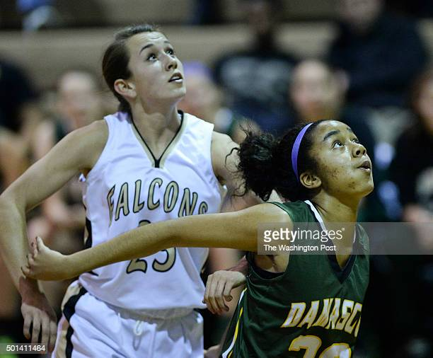 Poolesville's Rosie Barry left and Damascus freshman Tiana Stewart right push off each other under the basket during the game between between rivals...