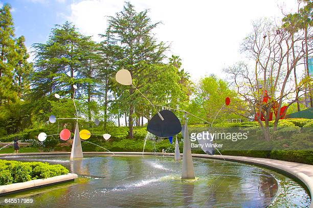 Pool/fountain with colorful sculptures, L.A.