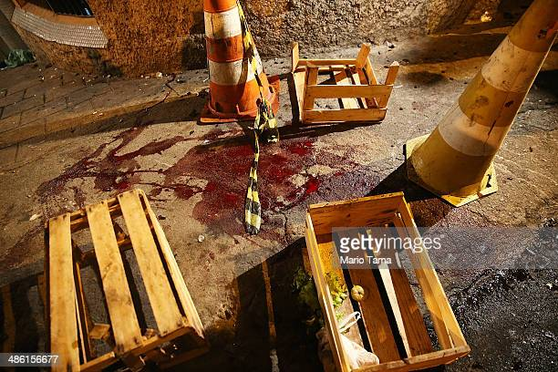 Pools of blood remain from where protesters allege a child was shot near the pacified PavaoPavaozinho community just blocks from Copacabana Beach on...