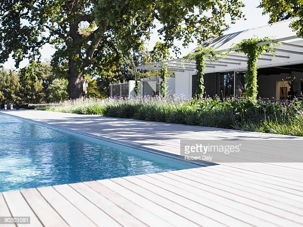poolside by swimming pool of modern home - poolside stock pictures, royalty-free photos & images