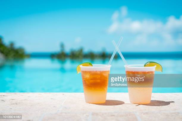 poolside drinks at a tropical resort - poolside stock pictures, royalty-free photos & images