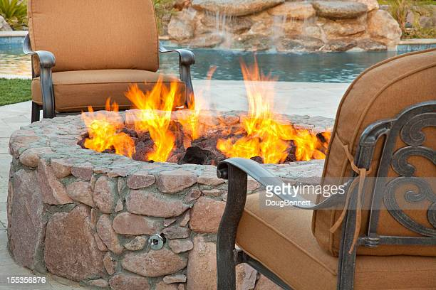poolside fireside seating - fire pit stock pictures, royalty-free photos & images