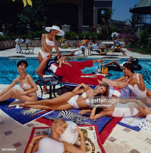 Poolside Man Surrounded by Beautiful Women