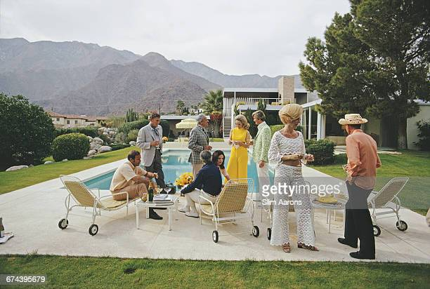 A poolside party at a desert house designed by Richard Neutra for Edgar J Kaufmann in Palm Springs January 1970 Featured in the group are industrial...