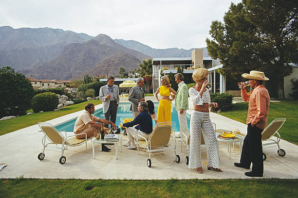 A poolside party at a desert house, designed by Richard...
