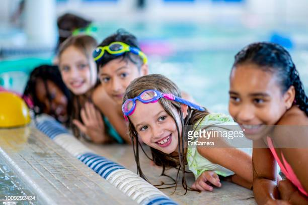 poolside - childhood stock pictures, royalty-free photos & images